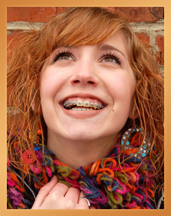 teen girl wearing braces and smiling